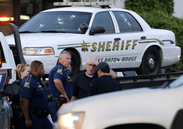 An East Baton Rouge Sheriff vehicle is seen with bullet holes in its windows near the scene where police officers were shot, in Baton Rouge, Louisiana, U.S. July 17, 2016.