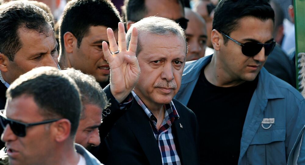 Turkish President Recep Tayyip Erdogan waves to the crowd following a funeral service for a victim of the thwarted coup in Istanbul, Turkey, July 17, 2016.