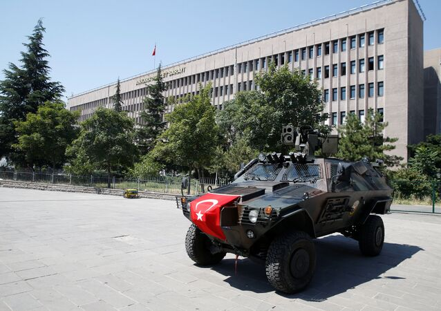 Members of police special forces keep watch from an armored vehicle in front of the Justice Palace in Ankara, Turkey, July 18, 2016.