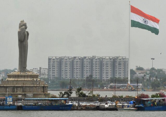 An Indian Tricolour flag flutters on an 83 metre (272.31 feet) flagpole  in Hyderabad