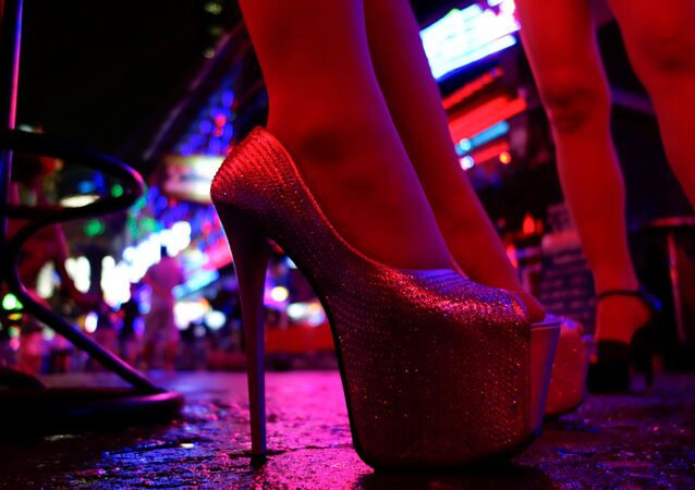 Women stand outside a bar in a red light district in Bangkok, Thailand, July 12, 2016. Picture taken July 12, 2016.