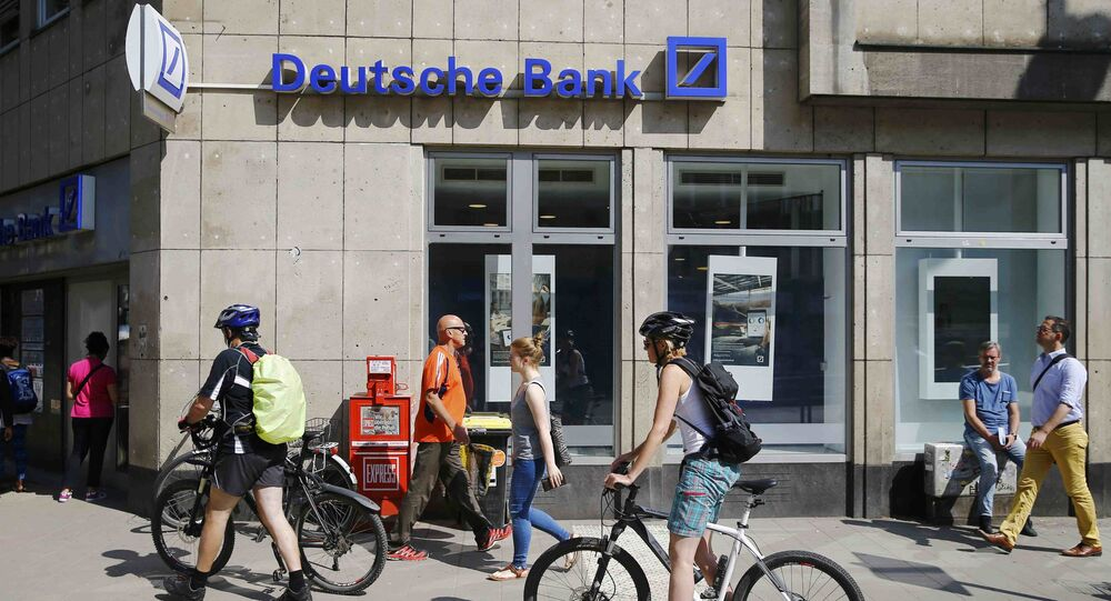 People pass in front of a branch of Germany's Deutsche Bank in Cologne, Germany, July 18, 2016