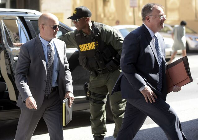 Lt. Brian Rice, left, one of the six members of the Baltimore Police Department charged in connection to the death of Freddie Gray, arrives with attorney Mike Davey, right, at a courthouse to hear a judge's ruling in his trial in Baltimore, Monday, July 18, 2016.