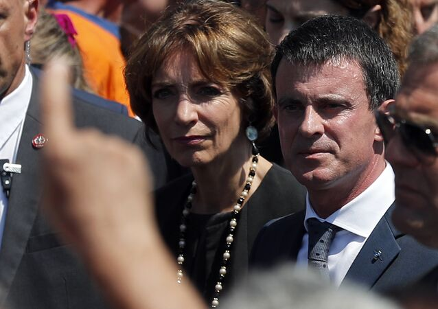 People boo French prime minister Manuel Valls, center, and Health Minister Marisol Touraine, left, after a minute of silence on the famed Promenade des Anglais in Nice, southern France, to honor the victims of an attack near the area where a truck mowed through revelers, Monday, July 18, 2016.