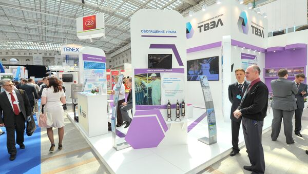 Participants of the 4th International Forum ATOMEXPO at the stand of Fuel Company TVEL set up at the specialized exhibition of nuclear industry and related sectors organizations - Sputnik International