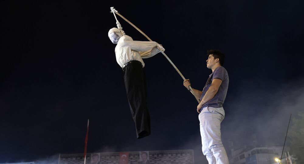 A Pro-Erdogan supporter holds an effigy of US based cleric Fetullah Gulen hanged by a noosed on during a rally at Taksim square in Istanbul on July 18, 2016