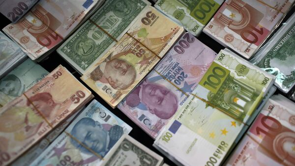 Turkish Liras, Euros and U.S. Dollars are stacked at a currency exchange office in Istanbul, Turkey (File) - Sputnik International