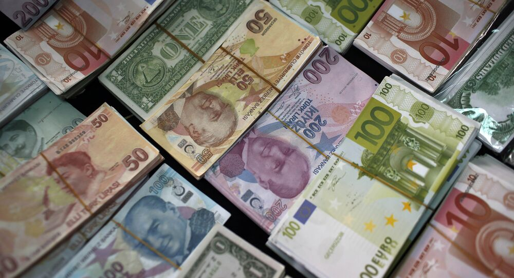 Turkish Liras, Euros and U.S. Dollars are stacked at a currency exchange office in Istanbul, Turkey (File)