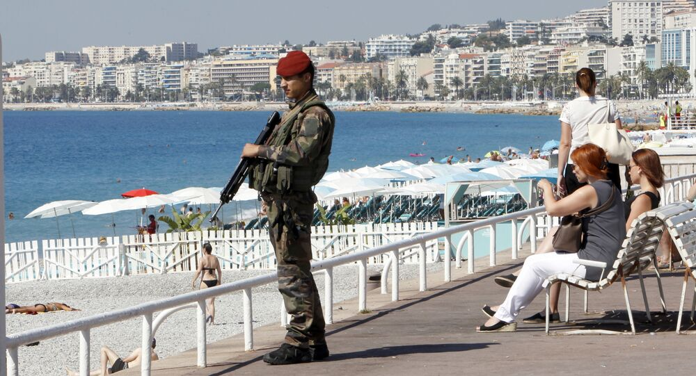A soldier secures the Promenade des Anglais in Nice, southern France, Monday, July 18, 2016, prior to a minute of silence to honor the victims of the Bastille Day attack on Thursday in Nice