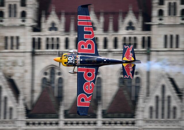 US Kirby Chambliss of the Team Chambliss with his Edge 540 V3 plane competes during the Red Bull Air Race World Championship over the river Danube in Budapest on July 17, 2016