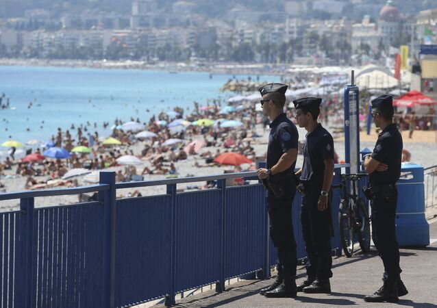 French police officers patrol on the famed Promenade des Anglais in Nice, southern France, three days after a truck mowed through revelers, Sunday, July 17, 2016.