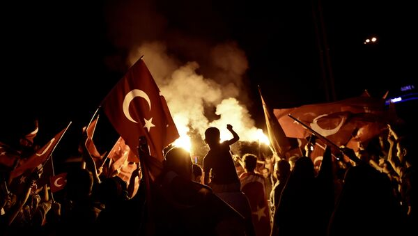 Pro-Erdogan supporters wave Turkish national flags during a rally at Taksim square in Istanbul on July 18, 2016 following the military failed coup attempt of July 15 - Sputnik International