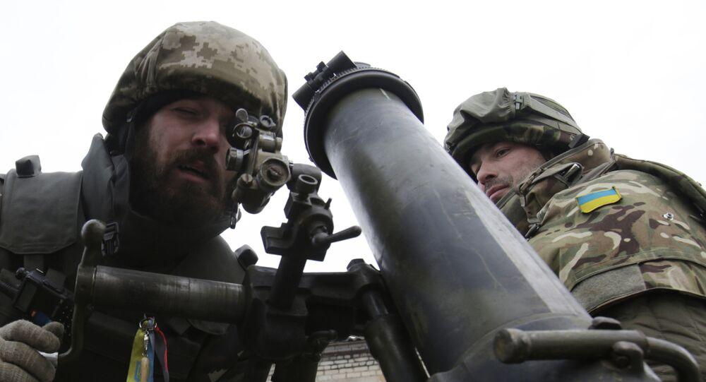 Ukrainian servicemen aim a mortar from their position near the eastern Ukrainian village Pisky, Donetsk region. File photo