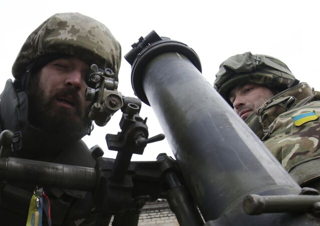 Ukrainian servicemen aim a mortar from their position near the eastern Ukrainian village Pisky, Donetsk region. File photo