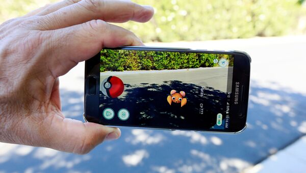 The augmented reality mobile game Pokemon Go by Nintendo is shown on a smartphone screen in this photo illustration taken in Palm Springs, California U.S. July 11, 2016 - Sputnik International