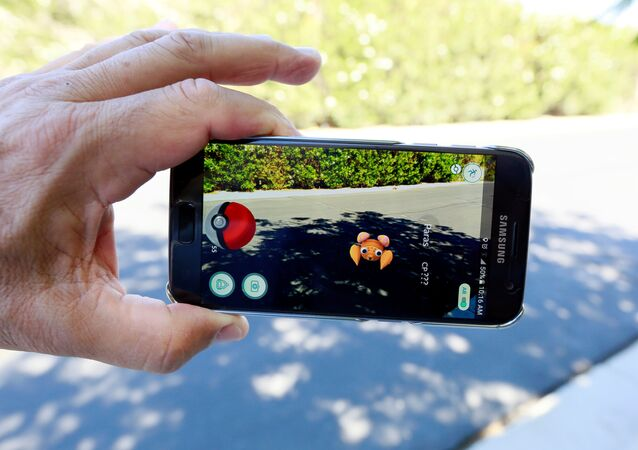 The augmented reality mobile game Pokemon Go by Nintendo is shown on a smartphone screen