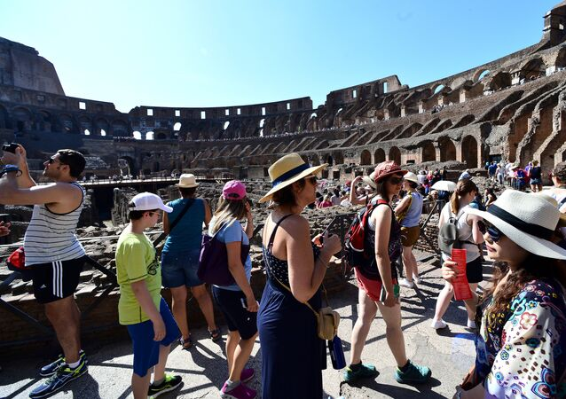 Tourists visit the ancient Colosseum on June 28, 2016 in Rome