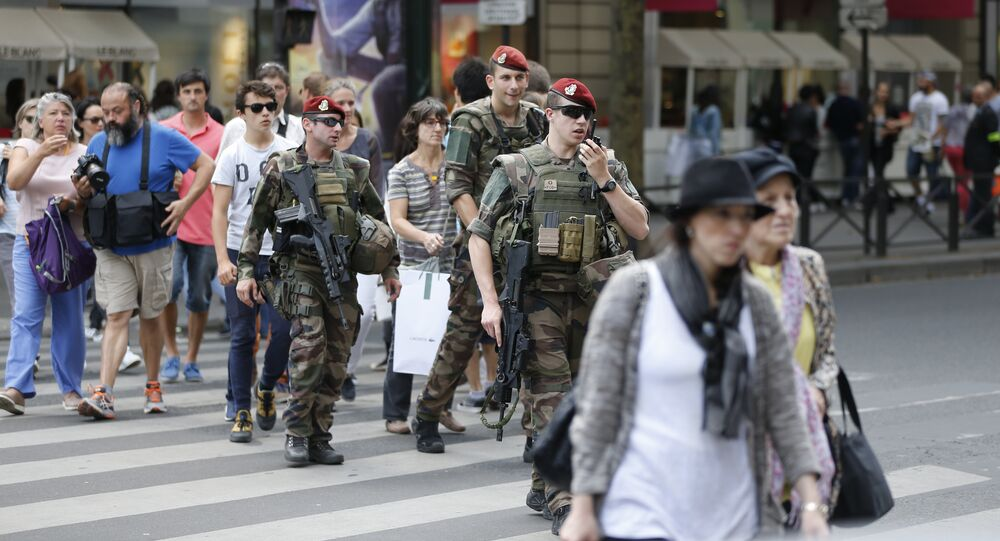 French soldiers anti-terror security forces operation Sentinelle patrol near the Galeries Lafayette in Paris on July 15, 2016, a day after the attack in Nice.