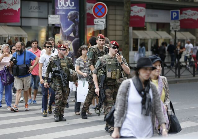 French soldiers anti-terror security forces operation Sentinelle patrol near the Galeries Lafayette in Paris on July 15, 2016, a day after the attack in Nice
