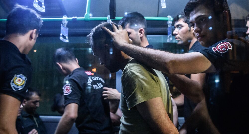 Turkish anti riot police officers detain a Turkish soldier who allegedly took part in a military coup as they are leaving in a bus the courthouse at Bakirkoy district in Istanbul on July 16, 2016