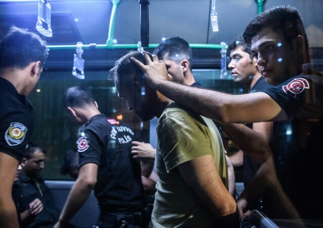 A file photo showing Turkish police officers detain a Turkish soldier who allegedly took part in a military coup as they are leaving in a bus the courthouse at Bakirkoy district in Istanbul on July 16, 2016