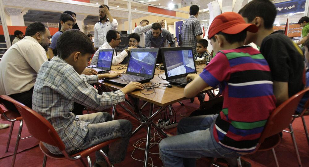 Iranians play computer games, in a computer games exhibition, at the Imam Khomeini grand mosque in Tehran, Iran (File)