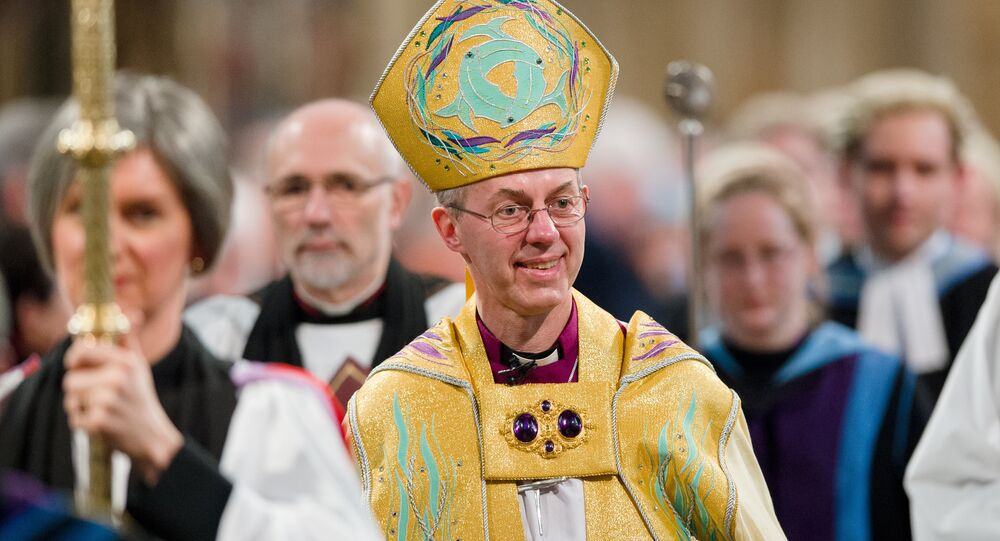 The Archbishop of Canterbury, Justin Welby (C) walks in procession after being Enthroned in Canterbury Cathedral in Canterbury on March 21, 2013.
