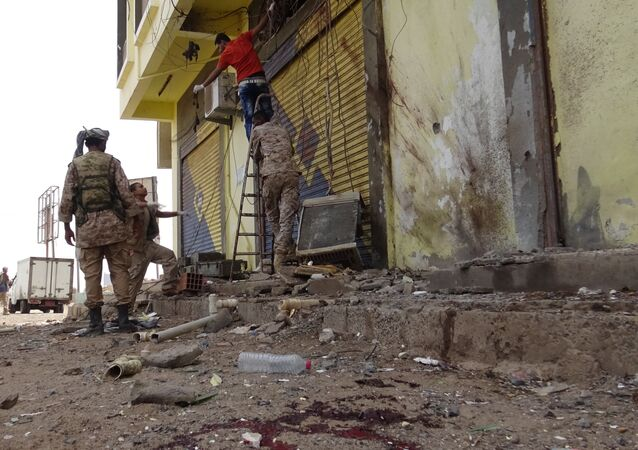 Soldiers inspect the site of a blast in the southern port city of Aden, Yemen, July 20, 2016