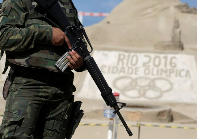 A Brazilian Army Forces soldier patrols on Copacabana beach ahead of the 2016 Rio Olympic games in Rio de Janeiro, Brazil, July 18, 2016