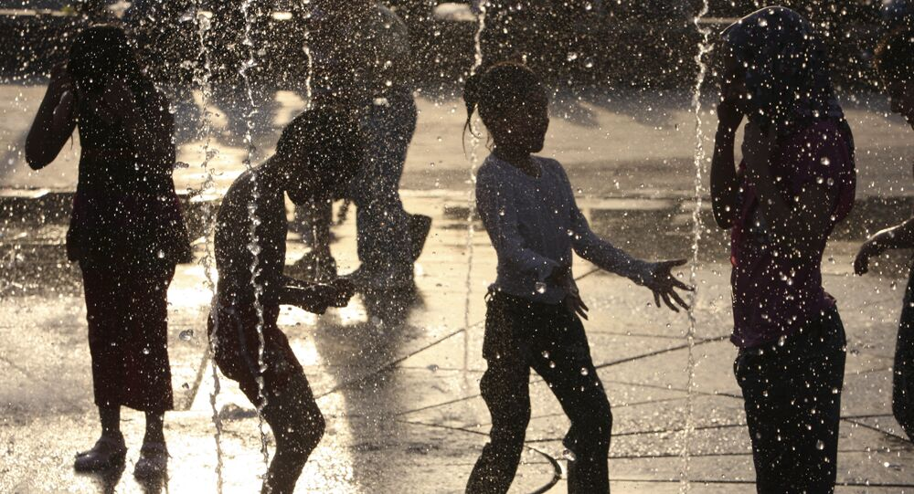 Iranian children enjoy a water fountain, while temperatures reach over 35 Celsius (95 Fahrenheit), at the Ebrahim (Abraham) Park in Tehran, Iran, Wednesday, July 13, 2011