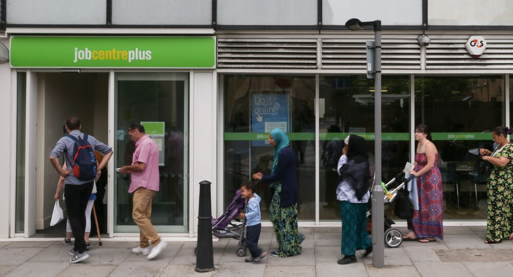 People queue to enter a job centre in east London on July 20, 2016