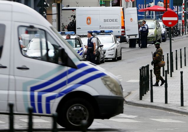 Belgian police officers and the anti-bomb squad are pictured after a man was seen wearing a thick coat with wires protruding from underneath in central Brussels, July 20, 2016