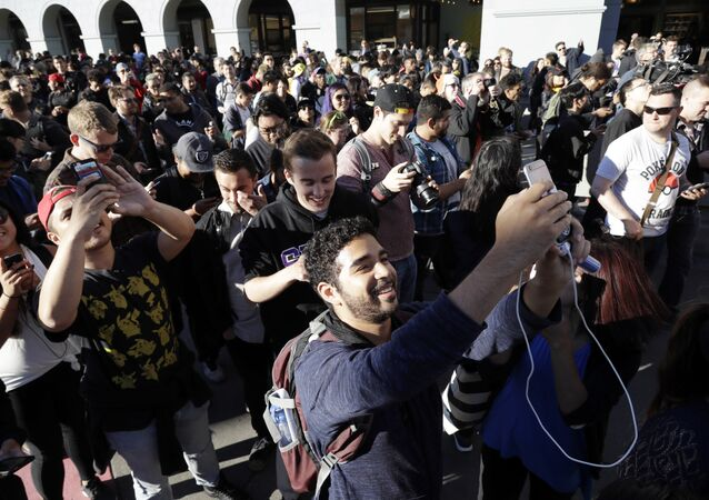 Pokemon Go players begin a group walk along the Embarcadero Wednesday, July 20, 2016, in San Francisco
