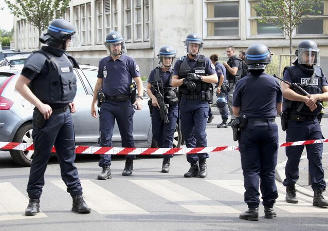French police secure a street as members of special forces carried out counter-terrorism swoop at different locations in Argenteuil, a suburb in northern Paris, France, July 21, 2016