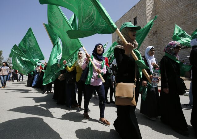 Palestinian students supporting the Hamas movement take part in a rally during an election campaign for the student council at the Birzeit University, near the West Bank city of Ramallah on April 26, 2016