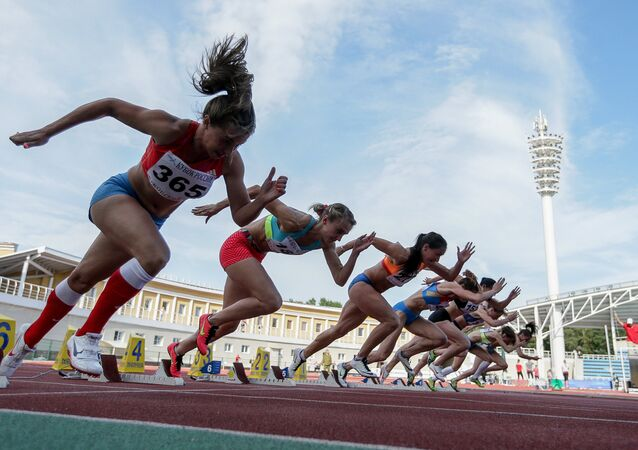 Athletes at the start of the women's 100m semifinal race at the Russian Track and Field Cup at the Meteor stadium in Zhukovsky, Moscow Region
