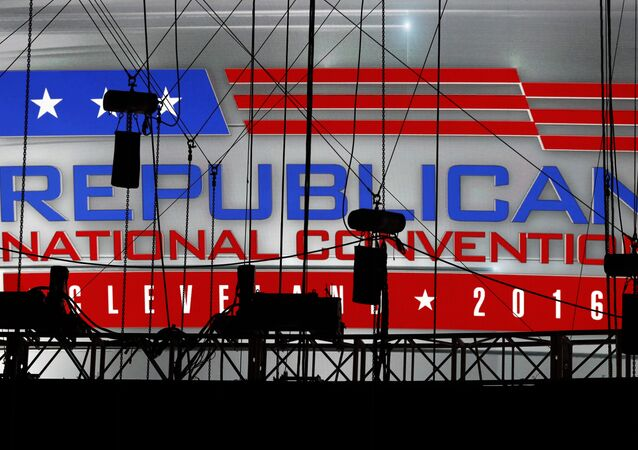 A Republican National Convention logo is seen though silhouetted production equipment on a huge video screen at Quicken Loans Arena for the Republican National Convention.