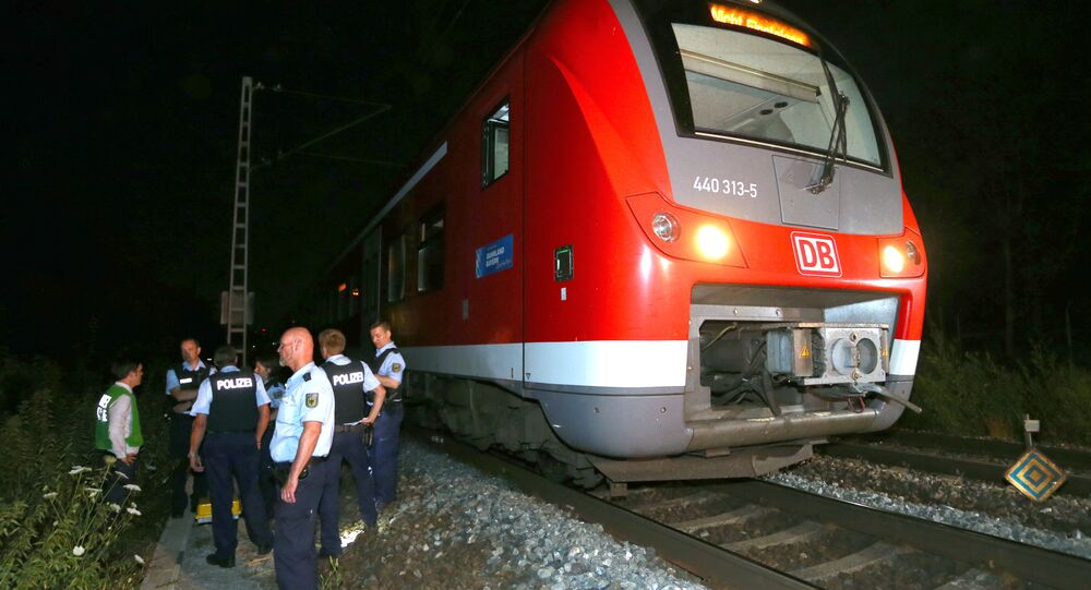 Police officers stand by a regional train in Wuerzburg southern Germany on July 18, 2016 after a man attacked train passengers with an axe