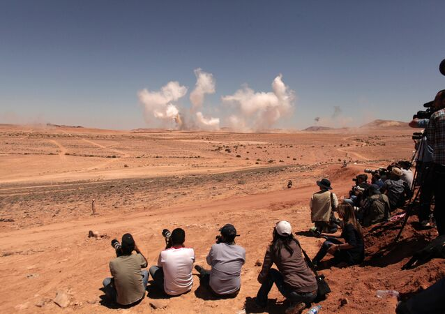 Journalists cover a combined air and ground exercise during  military maneuvers (File)