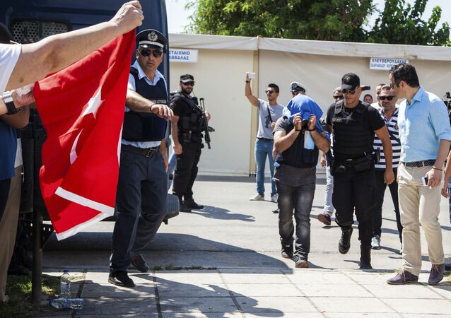 A Turkish military officer is transferred to a court hall in the city of Alexandroupolis, northern Greece, Thursday, July 21, 2016