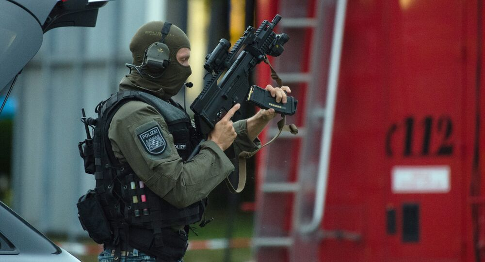 Police officer search a residential area near the Olympia shopping centre after a shooting was reported there in Munich.