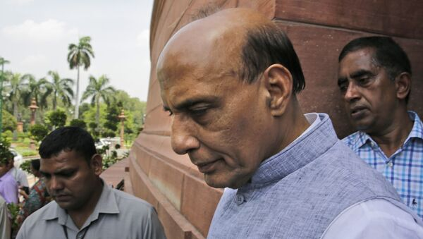Indian Home Minister Rajnath Singh, centre, comes out from parliament house. - Sputnik International
