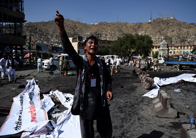 An Afghan protester screams near the scene of a suicide attack that targeted crowds of minority Shiite Hazaras during a demonstration at the Deh Mazang Circle in Kabul on July 23, 2016.