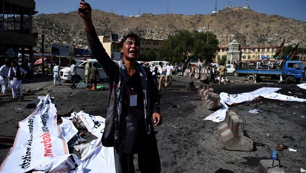 An Afghan protester screams near the scene of a suicide attack that targeted crowds of minority Shiite Hazaras during a demonstration at the Deh Mazang Circle in Kabul on July 23, 2016. - Sputnik International