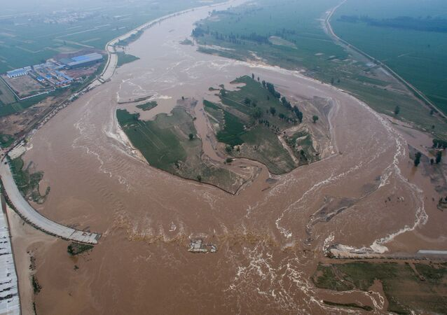 An aerial view shows that roads and fields are flooded in Xingtai, Hebei Province, China