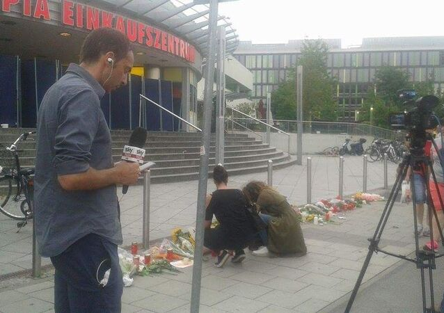 Flowers outside the Olympia shopping mall, where yesterday's shooting rampage started, in Munich, Germany