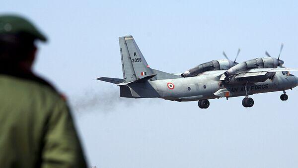 A soldier stands guard as an Indian Air Force AN-32 transport aircraft. - Sputnik International