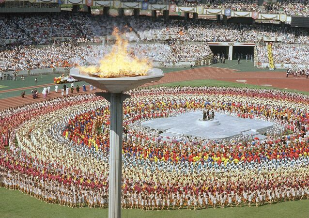 The Olympic torch towers above the Olympic stadium in Seoul Sept. 17, 1988, during the opening ceremonies for the summer Olympic Games in Seoul. (File)