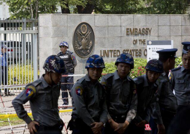 Myanmar police officers outside the US Embassy in Yangon.
