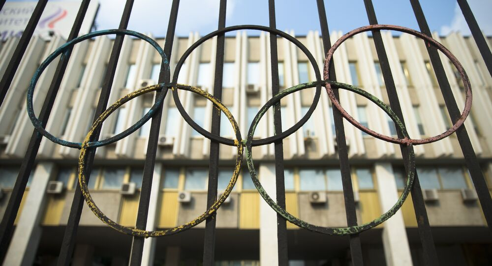 The Olympics rings are seen on a fence in front of the Russian Olympic Committee building in Moscow, Russia, Sunday, July 24, 2016.